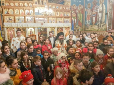 "His Grace Bishop Macarie at Copsa Mica, distributing social scholarships for poor children: ""The safest ""deposit"" we can open is the one in the heavens that awaits its interest"""