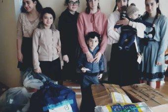 Darurile de Crăciun din Episcopia Europei de Nord au ajuns la 700 de bătrâni și copii nevoiași din România